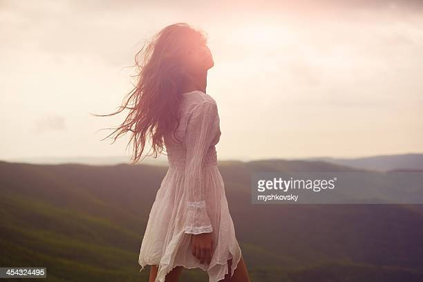 A beautiful woman walking around a mountainside