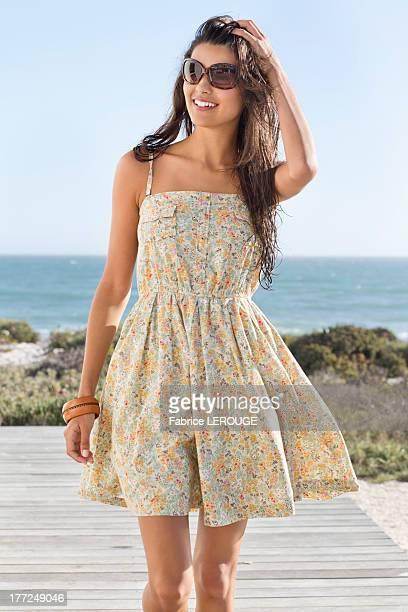 Beautiful woman walking on a boardwalk