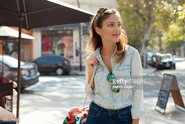 beautiful woman walking on city street