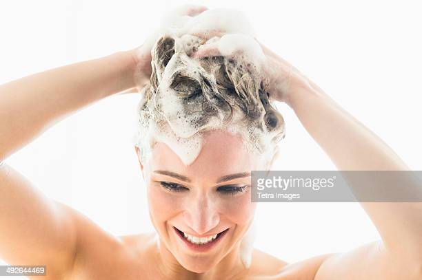 Beautiful woman washing hair