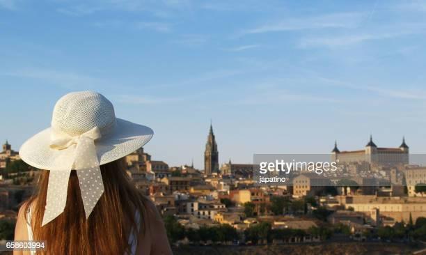 Beautiful woman watching the city of Toledo