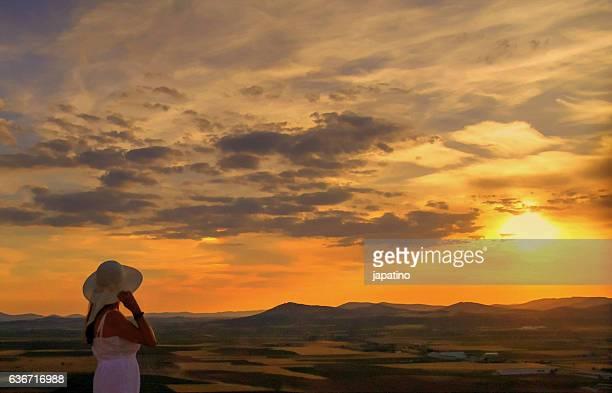 Beautiful woman watching the horizon and a beautiful sunset