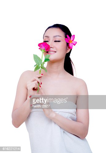 beautiful woman wear towel hold rose flower : Stock-Foto