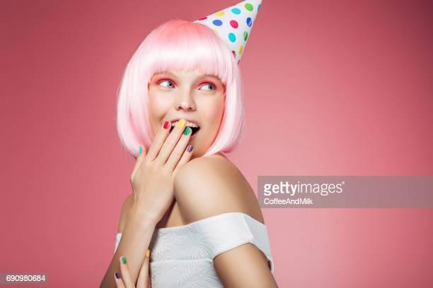 Beautiful woman wearing birthday cap