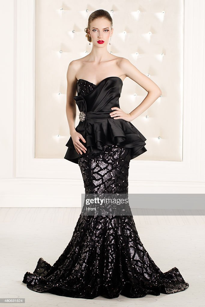 Beautiful woman wearing black elegant dress : Stock Photo