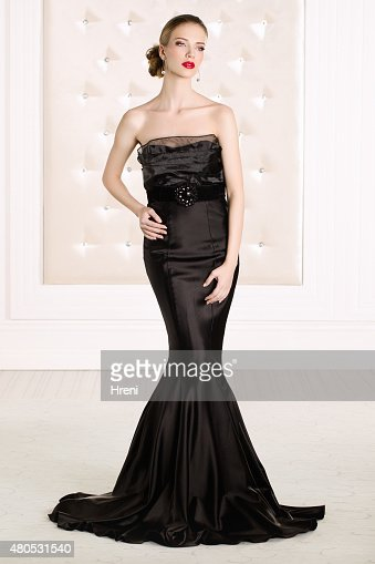 Beautiful woman wearing black elegant dress : Stock Photo