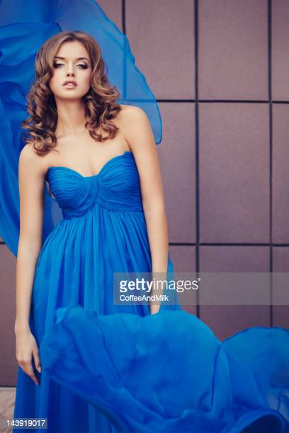 Beautiful woman wearing blue dress