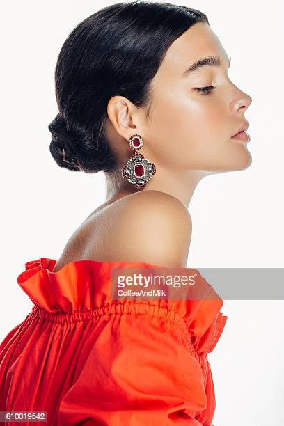 Beautiful woman wearing clothes and jewelry haute couture
