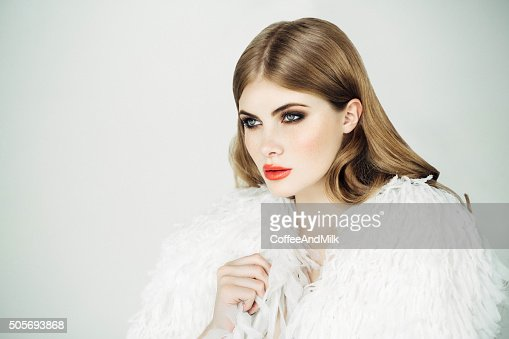 Beautiful woman wearing fur blouse