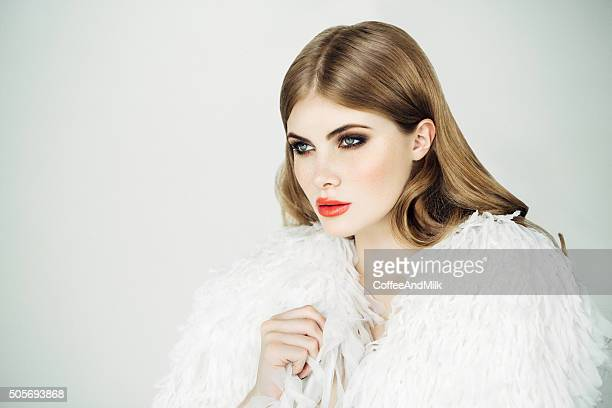 Beautiful woman wearing fur blouse