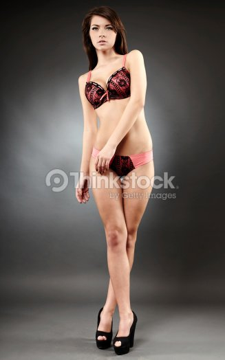 f5a2cf5ff32b Beautiful Woman Wearing Lingerie On Gray Background Stock Photo ...