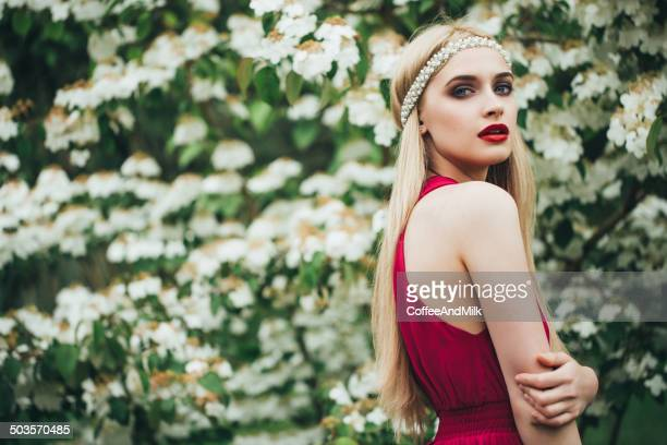 Beautiful woman wearing luxurious red dress