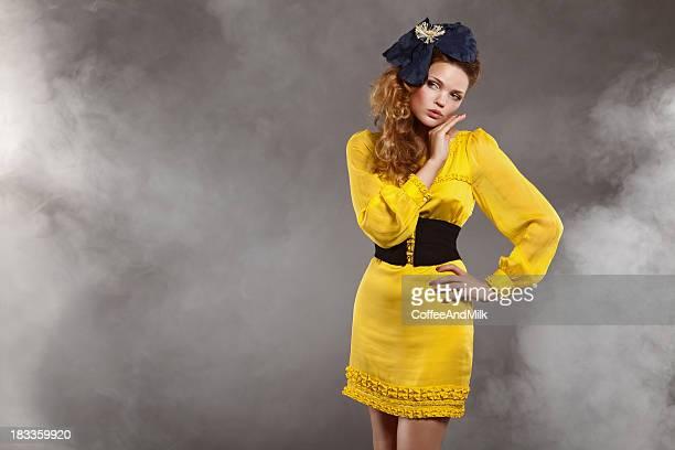 Beautiful woman wearing yellow mini-dress