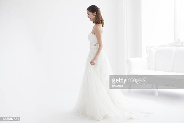 Beautiful woman wears a wedding dress.