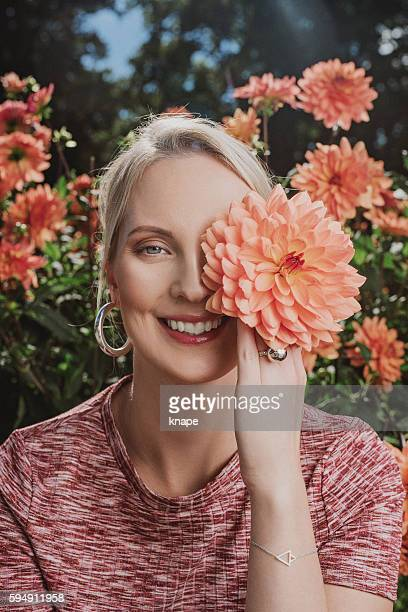 Beautiful woman with a dahlia in her face