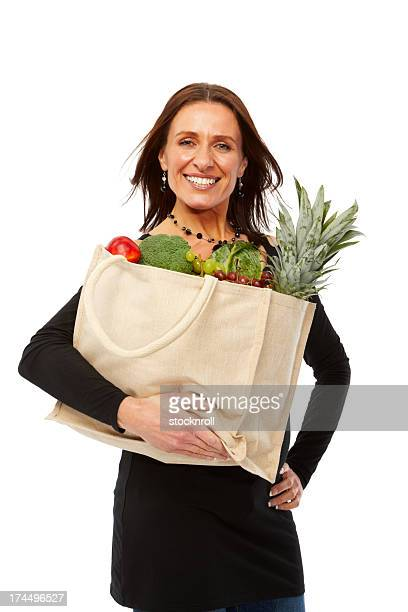 Beautiful woman with a grocery shopping bag