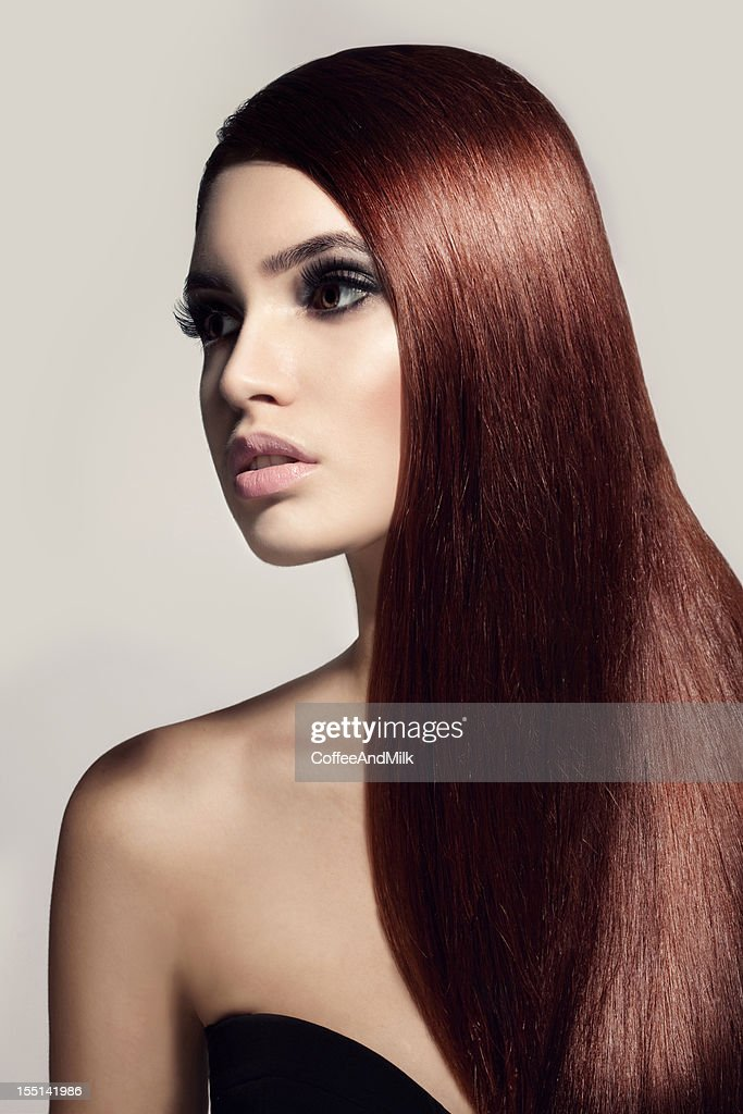 Beautiful woman with a luxurious hair : Stock Photo