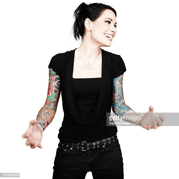 Beautiful woman with arm-sleeve tattoos expresses emotional intensity