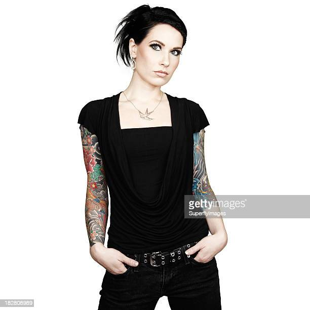Beautiful Woman with Arm-Sleeve Tattoos. Isolated on White Background.