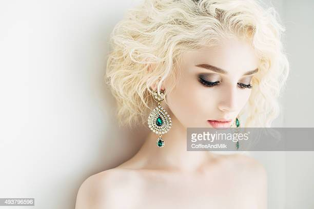 Beautiful woman with beautiful earings and hairstyle