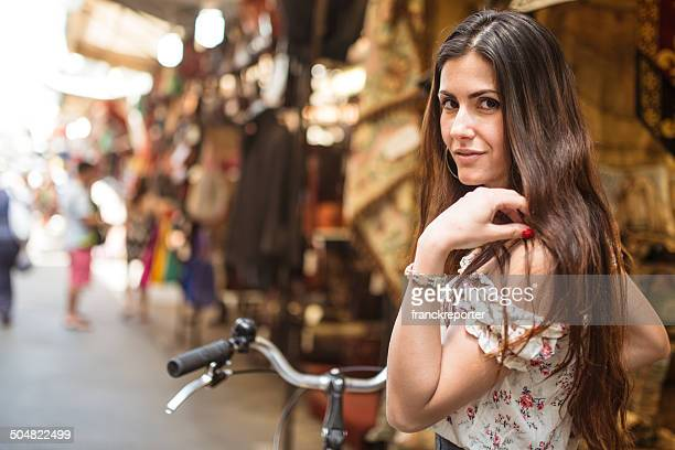 Beautiful woman with bike on a florence local market