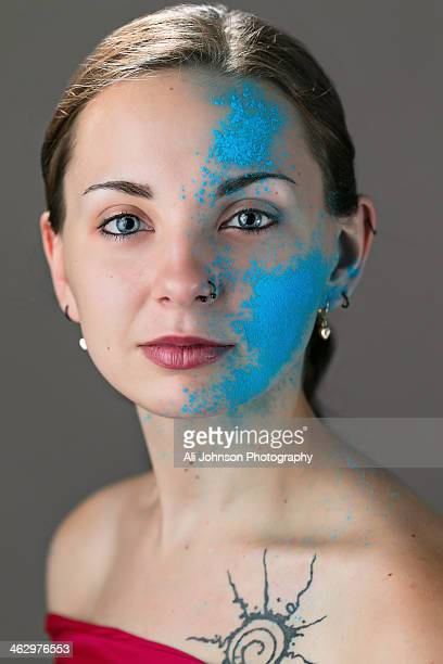 Beautiful woman with blue paint on her face