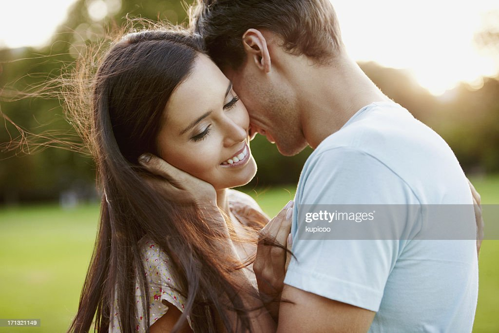 Beautiful woman with boyfriend in park : Stock Photo