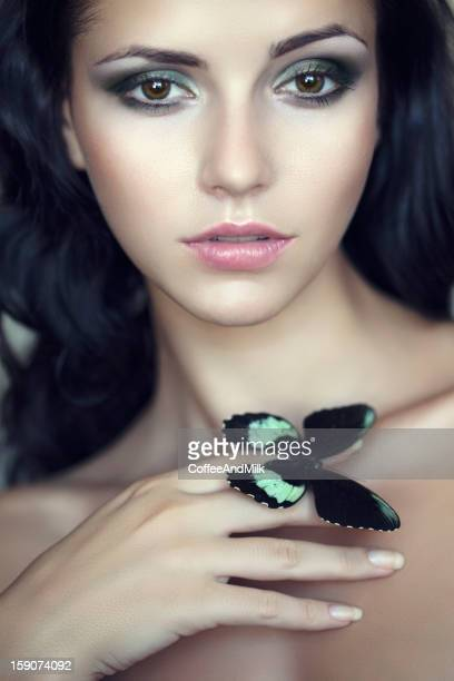 Beautiful woman with buterfly
