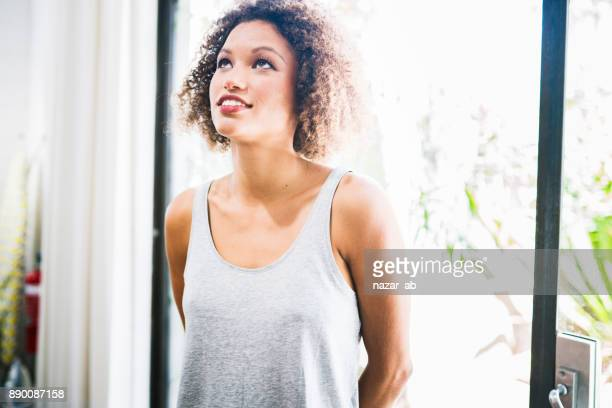 Beautiful woman with curly hair looking up.