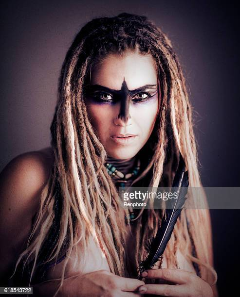 Beautiful Woman with Dreads and Crow Makeup