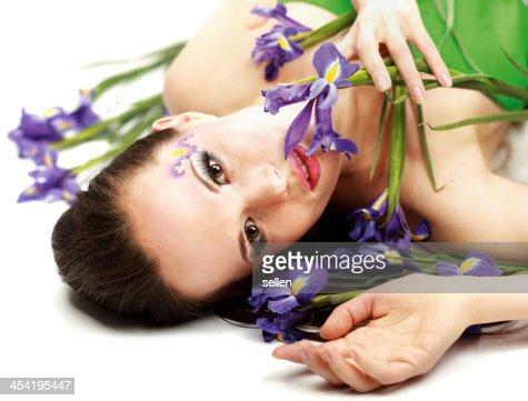 Beautiful woman with flower iris : Stock Photo
