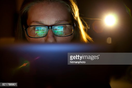 Beautiful Woman With Glasses Using Tablet Computer : Stock Photo