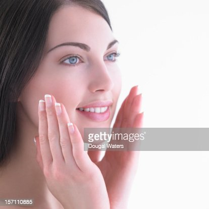 Beautiful woman with hands held up to face. : Stock Photo
