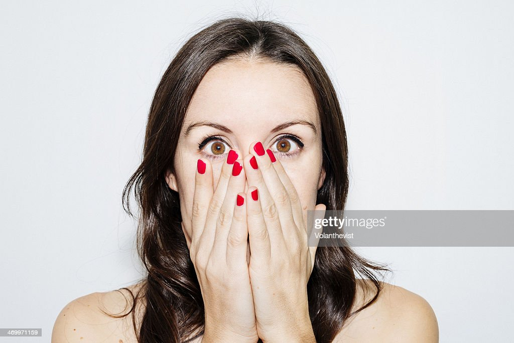 Beautiful woman with hands on face and red nails : Stock Photo