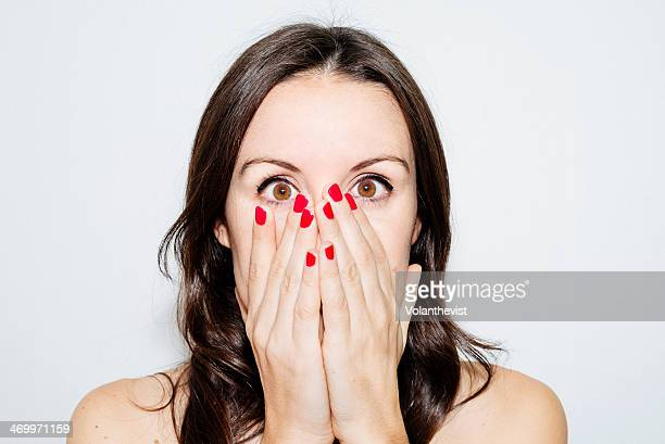 Beautiful woman with hands on face and red nails