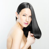 studio shot of a young fashion model with long natural hair