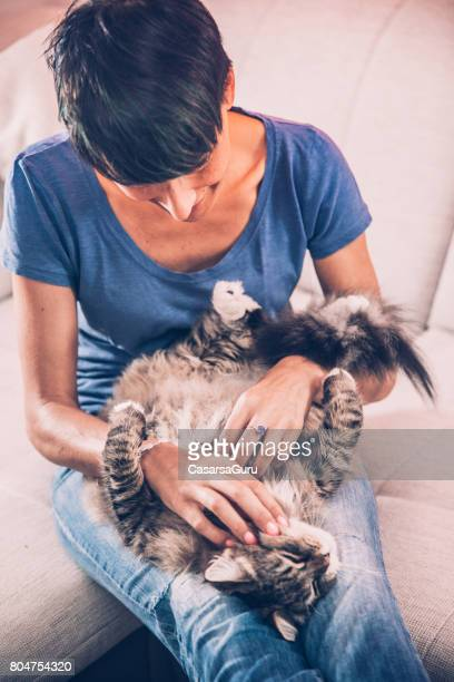 Beautiful Woman With Her Cute Striped Siberian Cat