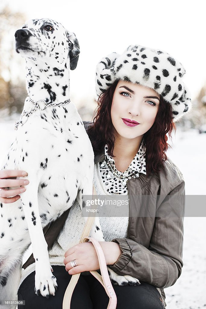 Beautiful woman with her dog : Stock Photo