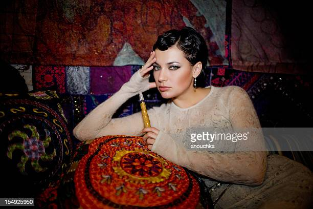 Beautiful Woman with hookakh in oriental decorated room