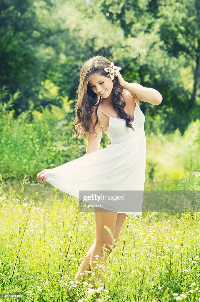 Beautiful woman with lilly flower enjoying on the meadow : Stock Photo