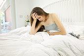 Unhappy sad woman feeling sick