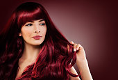 Fashion Portrait of Beautiful Woman with Long Healthy Hairstyle. Perfect Model with Red Hair