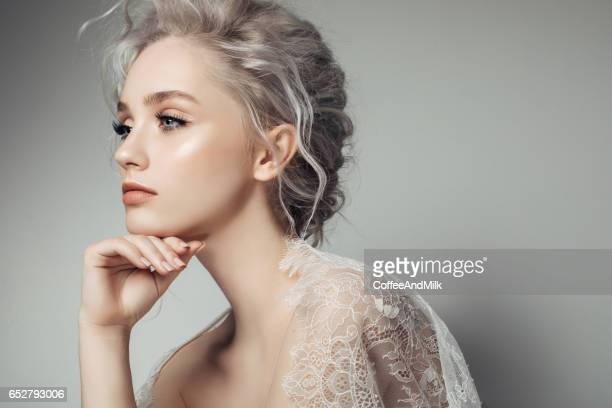 Beautiful woman with make-up and stylish hairstyle