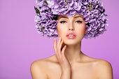 Beautiful woman with purple flowers