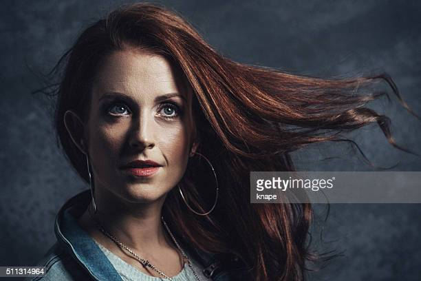 Beautiful woman with red hair and serious face