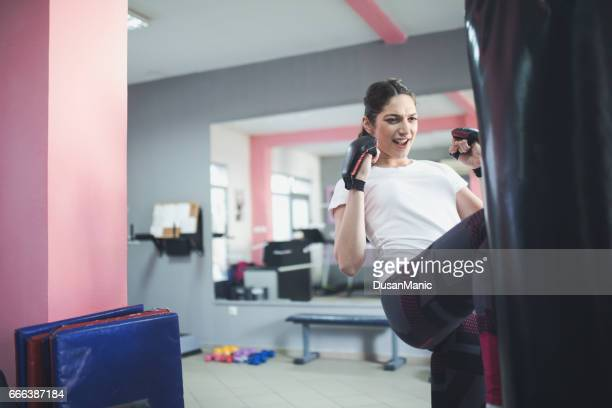 Beautiful Woman with the Boxing Gloves. Attractive Female Boxer Training.