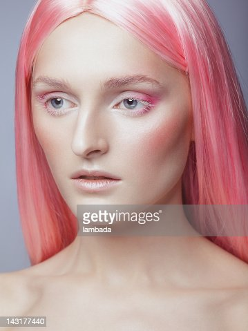 Beautiful woman with trendy hairstyle and make-up : Stock Photo