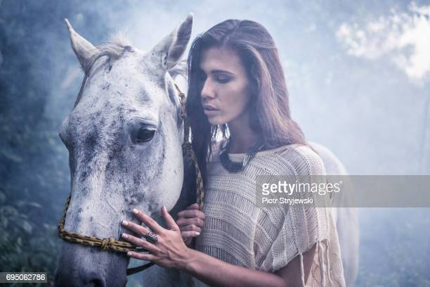 Beautiful woman with white horse
