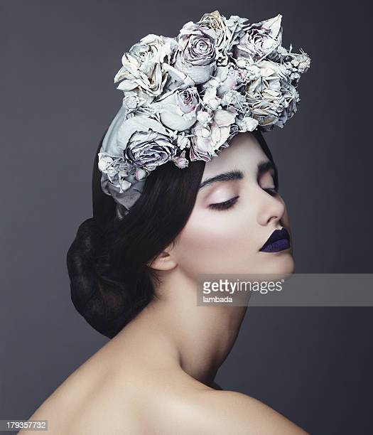Beautiful woman with wreath of flowers