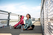 Beautiful women doing streching exercises outdoors.